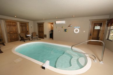 Dive Right In A 4 Bedroom Cabin With Indoor Pool In Laurel Estates.