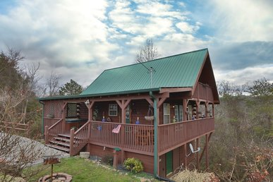 Fireside Memories a 2 bedroom cabin sleeping six. Wrap around wooden deck.
