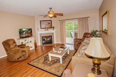 Hardwood Flooring • Recliner In Master Bedroom • City View