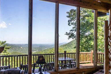 Panoramic views with wrap-around porch for relaxing family getaway