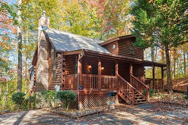 Semi-secluded 2 Bedroom, 2 Bath Cabin With An Amazing Covered Porch And Hot Tub.