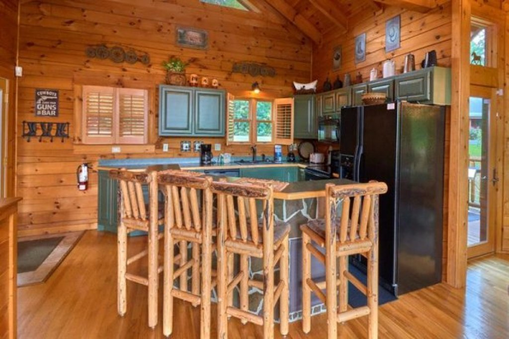Photo of a Sevierville Cabin named Wagon Wheel Cabin - This is the fourth photo in the set.