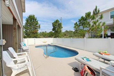 Welcoming home with Private Pool, Screened-in Porch and a short walk to the beach