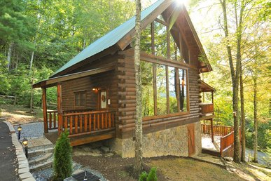 Secluded cabin with hot tub, wood-burning fireplace, pool table, & free passes to local attractions.