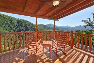 Private Cabin with wrap-around decks, pool table, hot tub, and free passes to local attractions.