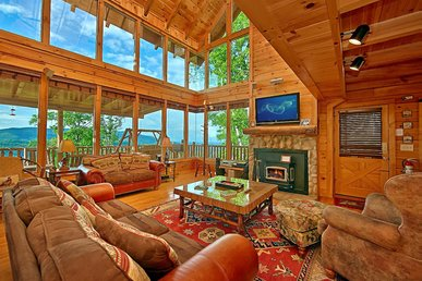 Spacious cabin with impressive views, private decks, hot tub, and free passes to local attractions.