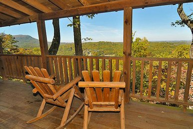 Pet-Friendly cabin with stone fireplace, lovely porch, hot tub, & free passes to local attractions.