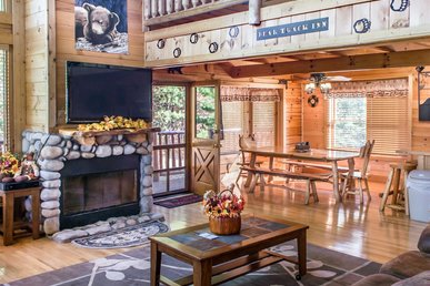 Spacious cabin with game room, hot tub, pool table, and free passes to local attractions.