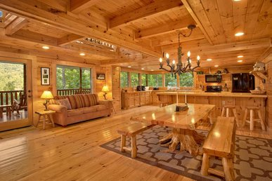 Roomy cabin with hot tub, four fireplaces, pool table, and free passes to local attractions