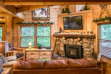 Idyllic cabin with stone-stacked fireplace, game room, and hot tub