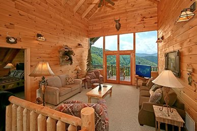 2 bedroom cabin with wrap-around deck, hot tub, fireplaces, & free passes to local attractions.
