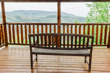 Spacious cabin with pool table, hot tub, private decks, and free passes to local attractions.
