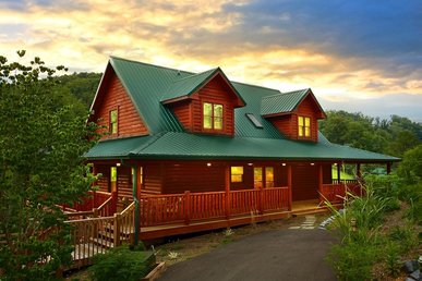 Pet-friendly cabin with pool table, hot-tub, wrap-around deck, & free passes to local attractions.