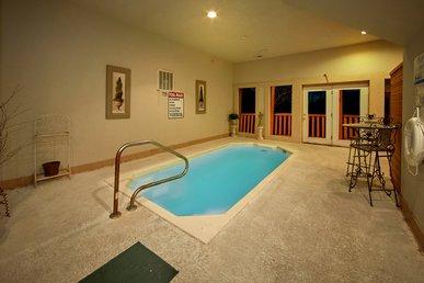 Amazing Indoor Pool Cabin - Pool Table, Hot Tub, Sauna, Covered Deck Sleeps 4