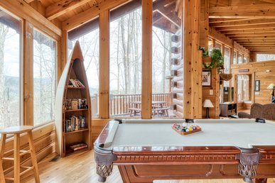 Pet-friendly cabin with hot tub, fireplace, and pool access
