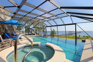 Bayside Beach House with Private, Screened in Pool and Spill-Over Hot Tub