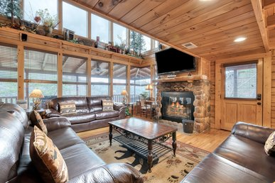 Impressive cabin with wrap-around decks, hot tub, fireplaces, and pool access