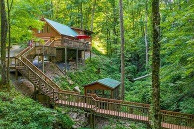 A 4 Bedroom, 2 Bath, Creekside, Semi-secluded Cabin Located In Shagbark Resort.