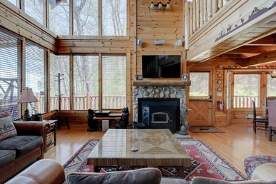 Spacious cabin with sensational views, hot tub, pool table, WIFI, and pool access