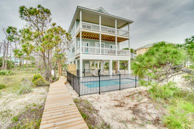 Gulf front Home with beautiful beach views  and private pool and boardwalk.
