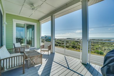 Hibiscus beach home with water views, community pool, and beach access