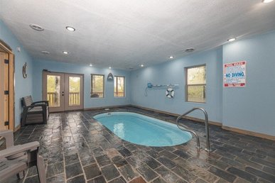 A 4 Bedroom, 4 Bath, Luxury Plus Cabin For 14 With A Private Indoor Pool.