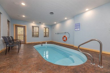 A 2 Bedroom, 2 Bath, Luxury Plus Cabin For 8 With A Private Indoor Pool & Games.