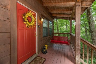 A 2 Bedroom, 2 Bath, Semi-secluded Deluxe Cabin Located In Sky Harbor Resort.